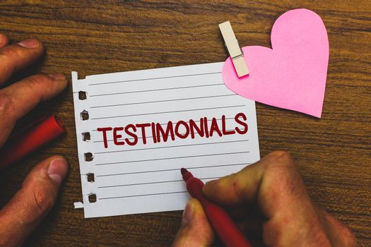 Writing note showing Testimonials. Business photo showcasing Customers formal endorsement statement experience of someone Small pitch paper clip paperclip love wood black shadow creative ideas