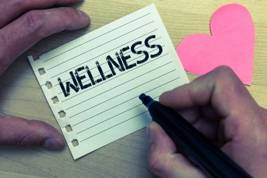 Text sign showing Wellness. Conceptual photo Making healthy choices complete mental physical relaxation Wood nice love colour hart marker pen art work memories black shadow