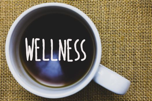 Handwriting text writing Wellness. Concept meaning Making healthy choices complete mental physical relaxation Mug coffee thoughts ideas creative inspirations nice mat black shadow