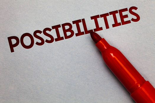 Text sign showing Possibilities. Conceptual photo Things that may happen or be the case State of being possible White paper lite grey shadow red marker pen nice idea memorable thought