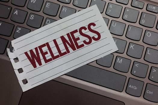 Writing note showing Wellness. Business photo showcasing Making healthy choices complete mental physical relaxation Keyboard colour grey paper keys laptop creative idea computer keypad