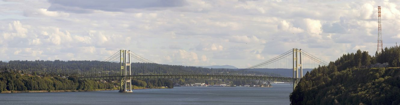 Tacoma Narrows Bridge over strait of Puget Sound connecting Tacoma and Kitsap Peninsula daytime scenic view panorama