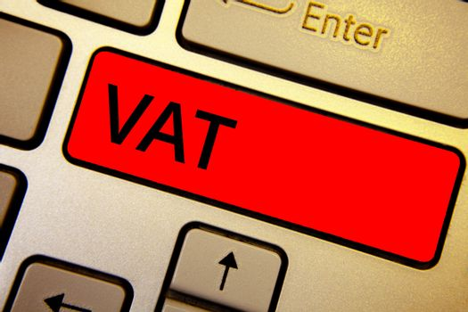 Text sign showing Vat. Conceptual photo Consumption tax levied on sale barter for properties and services Keyboard brown keys yellow laptop idea create computer keypad laptop