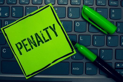 Conceptual hand writing showing Penalty. Business photo text Punishment imposed for breaking a law rule or contract Sports term Keyboard sticky card marker pen office job computer study class