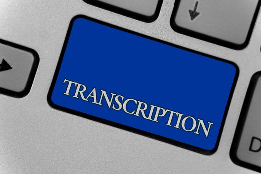 Conceptual hand writing showing Transcription. Business photo text Written or printed process of transcribing words text voice Keyboard grey key silver laptop create computer keypad notebook