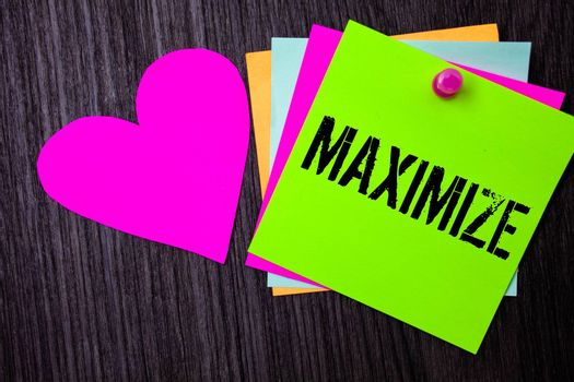 Conceptual hand writing showing Maximize. Business photo text Increase to the greatest possible amount or degree Make larger Pinned multi colour cards heart polish dark lining background