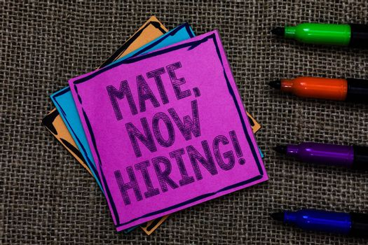 Text sign showing Mate, Now Hiring Motivational Call. Conceptual photo Workforce Wanted Employees Recruitment Multiple colour sticky remember cards pen script marker jute background