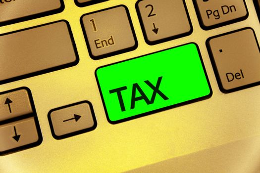 Text sign showing Tax. Conceptual photo Compulsory payment of taxes by people to government increase revenue Keyboard key laptop creative computer brown keypad idea notebook netbook