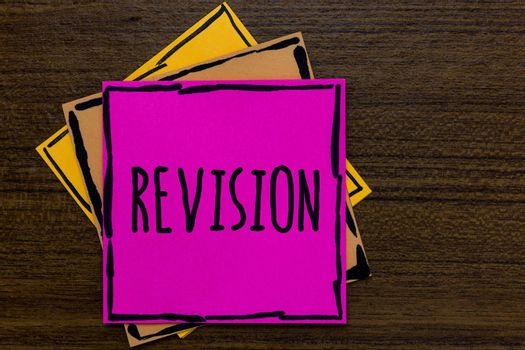 Writing note showing Revision. Business photo showcasing Rechecking Before Proceeding Self Improvement Preparation Three art small paper two yellow one pink wood brown lite grey shadow