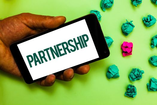 Conceptual hand writing showing Partnership. Business photo text Association of two or more people as partners Cooperation Unity Text message smart screen mobile handset crumpled small balls