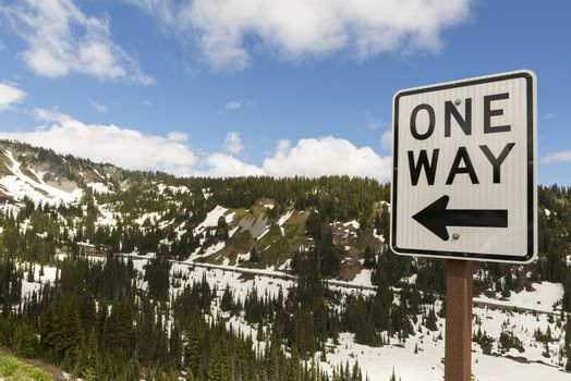 One Way drive along highway in scenic Mount Rainier National Park Washington State