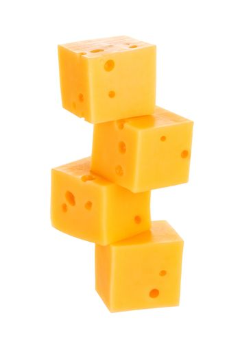 Cubes of cheese isolated on white background. With clipping path.