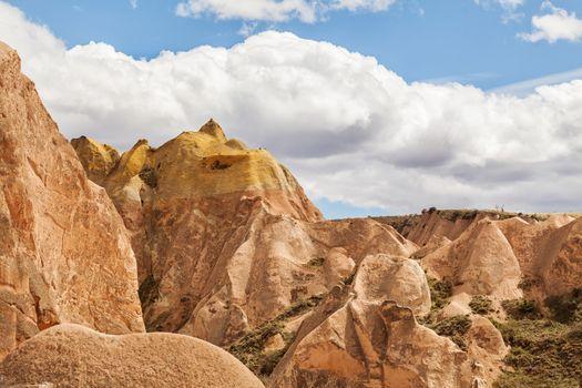 Beautiful stone cliffs in valley named Rose valley near Meskendir, Goreme, Turkey