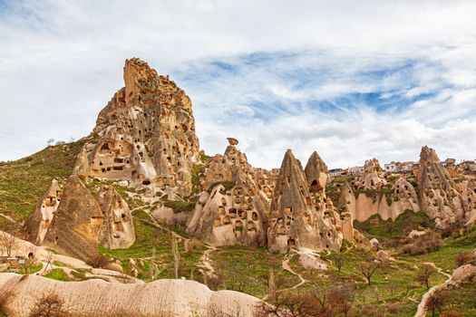 Stone cliffs and cave houses in Uchisar near Goreme, Turkey