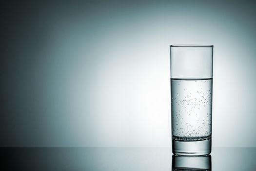 Glass of water with reflection