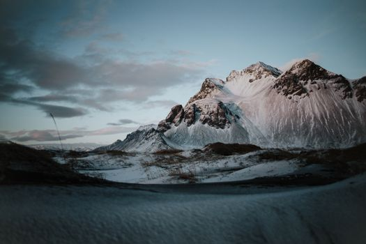 The snow covered landscape of Stokksnes, Iceland at sunset.