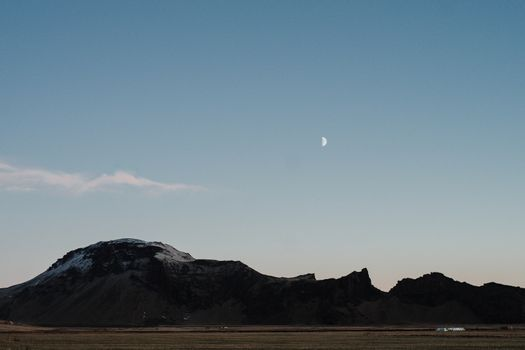 A mountain under the moon in Iceland