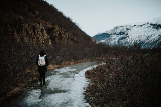 A person walking a path in iceland