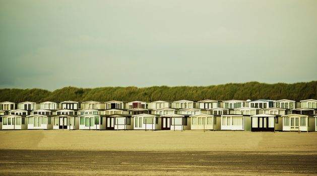 Beach Houses on North Sea coast in Netherlands Outdoors. Retro Styled