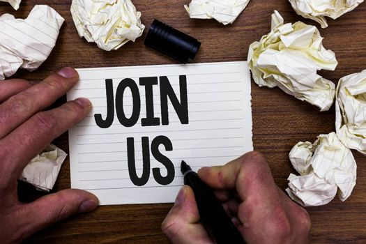 Word writing text Join Us. Business concept for Register in community Team or blog Sign up at social media Man holding marker notebook page crumpled papers several tries mistakes