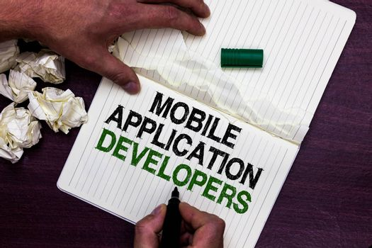 Text sign showing Mobile Application Developers. Conceptual photo create software for devices like Android Man holding marker notebook page crumpled papers several tries mistakes
