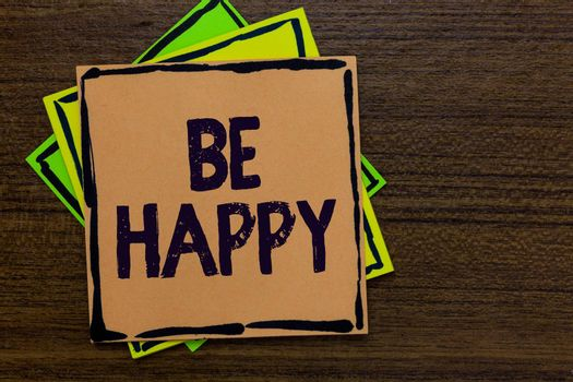 Word writing text Be Happy. Business concept for live every moment as the last love your life work family Paper notes Important reminders Express ideas messages Wooden background
