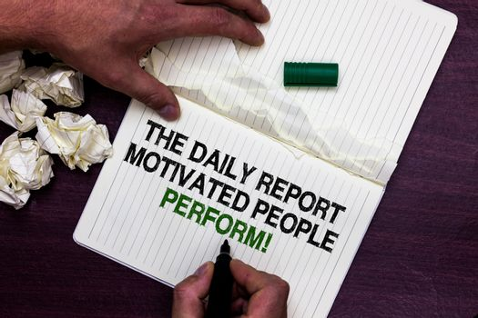 Text sign showing The Daily Report Motivated People Perform. Conceptual photo assignment created to rate workers Man holding marker notebook page crumpled papers several tries mistakes