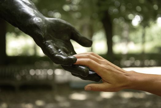 Rodin statue with human hands