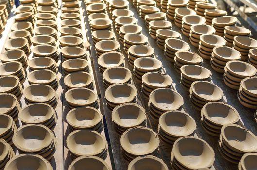 Ceramic cup in rack prepare for bring in furnace in factory
