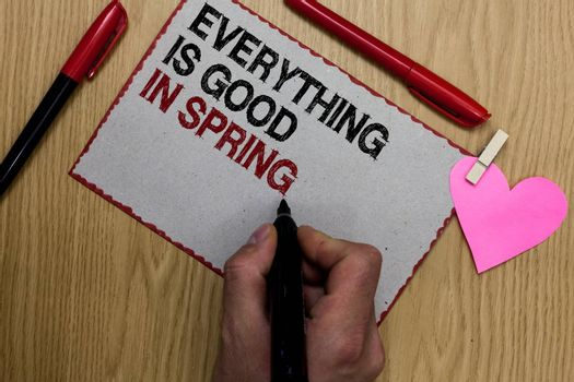 Text sign showing Everything Is Good In Spring. Conceptual photo Happiness for the season Enjoy nature Written sticky note clip pinch heart hand hold marker red pen on wooden desk
