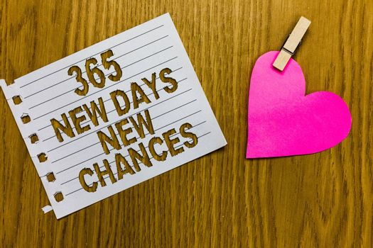 Conceptual hand writing showing 365 New Days New Chances. Business photo showcasing Starting another year Calendar Opportunities Yellow woody deck word with white page paper clip grip heart