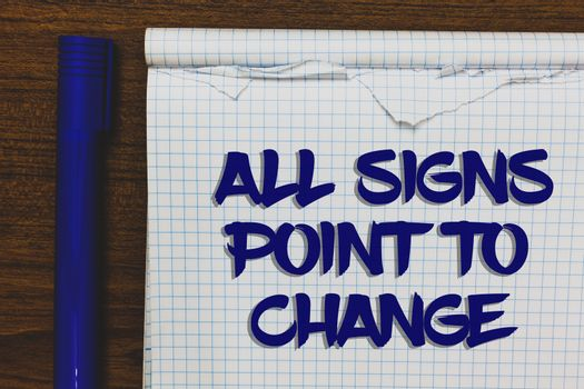 Writing note showing All Signs Point To Change. Business photo showcasing Necessity of doing things differently new vision Written white notepad on grey wooden background beside blue marker