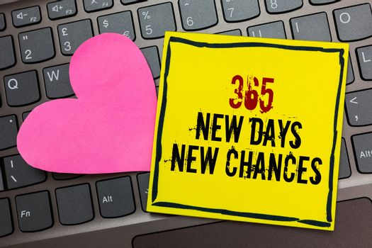 Handwriting text writing 365 New Days New Chances. Concept meaning Starting another year Calendar Opportunities Written on black bordered yellow page touched pink heart on computer keyboard