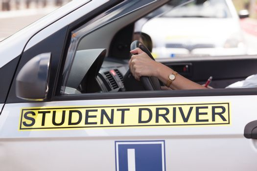Learning to drive a car. Driving school. Driver education.