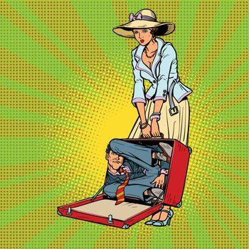 Husband in suitcase. Woman traveler