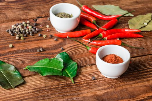 Different condiment in bowls or scattered on kitchen table.