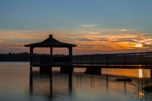 Gazebo in Lake wat Sunset.