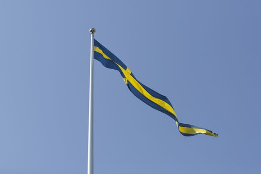 Swedish Pennant with a clear blue sky.