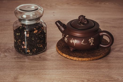 Asian teapot on stand and jar
