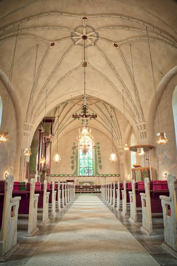 Inside Church with Rows of Benches.