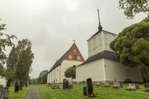 Church at Backen, Umea, Sweden with a cloudy sky.