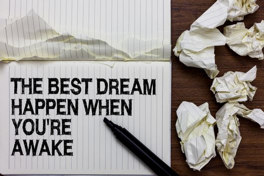 Handwriting text writing The Best Dream Happen When You re are Awake. Concept meaning Dreams come true Have to believe Marker over notebook crumpled papers ripped pages several tries mistakes