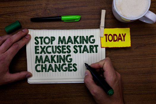 Word writing text Stop Making Excuses Start Making Changes. Business concept for Do not give an excuse Act instead Man holding marker notebook clothespin reminder wooden table cup coffee