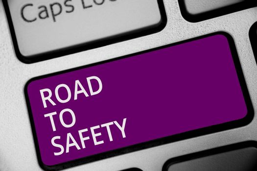 Word writing text Road To Safety. Business concept for Secure travel protect yourself and others Warning Caution Keyboard purple key Intention create computer computing reflection document