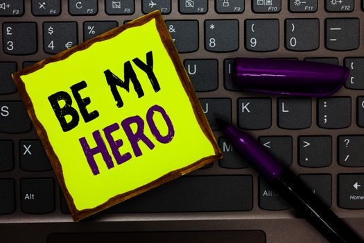Handwriting text Be My Hero. Concept meaning Request by someone to get some efforts of heroic actions for him Yellow paper keyboard Inspiration communicate ideas messages black markers