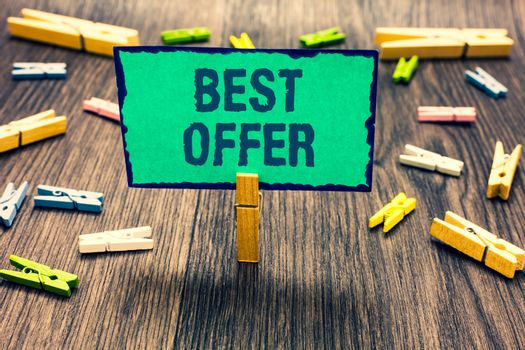 Word writing text Best Offer. Business concept for To convince someone by rendering all the greatness you can give Clothespin holding green paper note several clothespins wooden floor