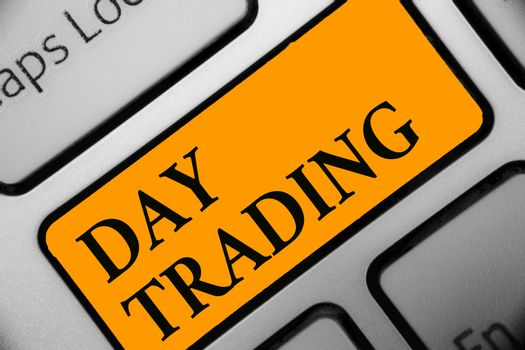 Writing note showing Day Trading. Business photo showcasing securities specifically buying and selling financial instruments Keyboard orange key Intention computer computing reflection document.