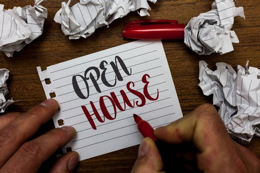 Handwriting text Open House. Concept meaning you can come whatever whenever want Make yourself at home Man holding marker notebook page crumpled papers several tries mistakes