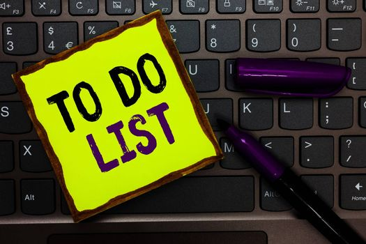 Handwriting text To Do List. Concept meaning A structure that usualy made in paper contining task of yours Yellow paper keyboard Inspiration communicate ideas messages black markers