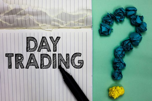Conceptual hand writing showing Day Trading. Business photo text securities specifically buying and selling financial instruments Notebook marker crumpled papers question mark on green background.